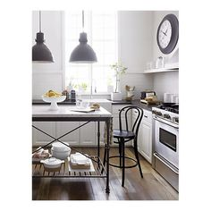 @Susan Bynum.  This kitchen seems to have all the elements you like.. French bistro w. modern subway tiling.  and the light fixtures!