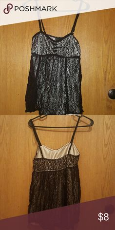 Forever 21 black lace baby doll tank top Adorable floral lace on top of silky cream colored material. Forever 21 Tops Tank Tops