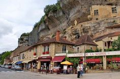 Les Eyzies de Tayac - a picturesque town in the Dordogne region, with calm canoing on the adjacent river and troglodyte dwellings in the cliffs above the main street.