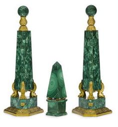A pair of Continental Neoclassical style gilt bronze mounted malachite veneered obelisks 20th century height 20 1/2in (52cm) together with A Neoclassical style gilt bronze mounted malachite veneered obelisk, 20th century height 10in (25.5cm)