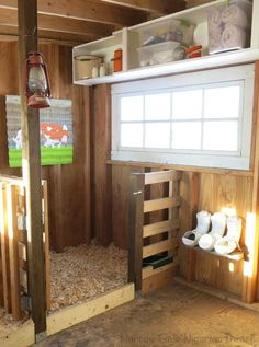 Storage shelf in goat barn & stalls made out of pallets Backyard Farming, Chickens Backyard, Tier Zoo, Goat Playground, Goat Shed, Goat Shelter, Barn Stalls, Goat Barn, Dwarf Goats