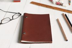 DIY Leather Sketchbook using album posts. For those that can't get their heads around binding.