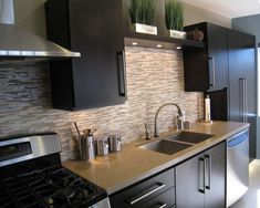 Shelf with lights above sink for a visual stop to the backsplash tile. Houzz. http://www.houzz.com/photos/77067/A-S-D--Interiors-kitchen-remodel-contemporary-kitchen-los-angeles#spaceQuestions