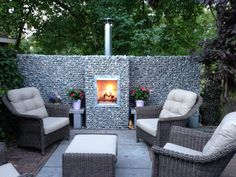 Baskets and fireplaces modern gardeco modern garage homify, Here you will find all photos with living ideas. Backyard Fireplace, Fire Pit Backyard, Backyard Patio, Backyard Landscaping, Outdoor Bbq Kitchen, Outdoor Fire, Outdoor Decor, Landscaping Retaining Walls, Garden Design Plans