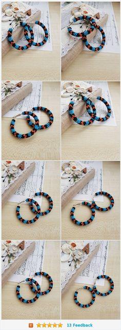 #Nativeamerica inspired beaded #hoopearrings Pierced stud #earrings #Huichol Blue black orange Beadwork snake serpent circle #jewelry Big hoops https://www.etsy.com/IvonaHMJewelry/listing/586584555/native-america-inspired-beaded-hoop?ref=shop_home_active_10