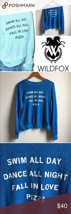 "NWT Wildfox Swim All Day Sweatshirt Jumper Brand new with tags Wildfox Sweatshirt in blue (not aqua). Swim all day. Dance all night. Fall in love. Pizza. 47% polyester, 47% Rayon, 6% spandex. Length: XS 23"", S 24"", Bust flat from pit to pit XS 22"", S 23"" Wildfox Sweaters"
