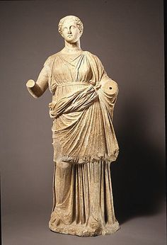 This is a depiction of an ideal Greek woman from the Classical period. She is tall, beautiful, and dressed modestly.