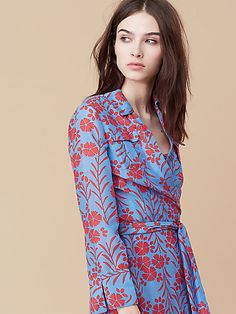 This breezy midi-length collared wrap dress is cut in lightweight floral printed cotton.