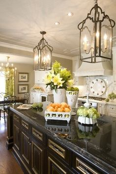 The lanterns and dark island are bold but really set this kitchen apart.