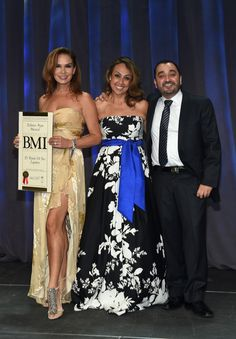 Elisa Beristain and Alejandro Garza on stage collecting the BMI Latin Song of the Year award with BMI's Delia Orjuela at BMI's 22nd Annual Latin Music Awards at Fountainbleau Miami Beach on March 31, 2015 in Miami Beach, Florida.