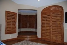 """Custom 4 1/2"""" stained knotty alder shutters in master bedroom in Muth Valley. www.sandiego-shutters.com"""