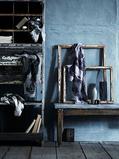 Indigos and worn blues mixed with shabby off white and rustic wood tones