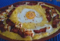 """Mămăligă, you say? I can imagine most people asking themselves: """"What the hell is that?"""" I didn't have a clue either. Mămăligă is Romanian for polenta or cornmeal. My discovery of the year has to b… Polenta, Valencia, Discovery, Eggs, Cheese, Breakfast, People, Recipes, Food"""
