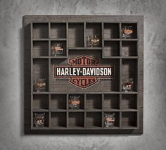 Don't hide those souvenir shot glasses from cross-country rallies in a cupboard. When buddies come over, set up the shots and start reminiscing. With slots for 24 glasses it might be a long night… | Harley-Davidson Wooden Shot Glass Display Case