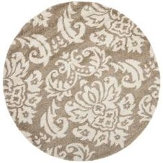 @Overstock - This casual shag area rug combines neutral tones and a plush feel to make a wonderful accent for any room. The beige print is subtle, yet attractive, and the high-density pile makes this rug feel luxurious underfoot.http://www.overstock.com/Home-Garden/Ultimate-Beige-Shag-Rug-6-7-Round/6372275/product.html?CID=214117 $136.79