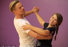 It's all new to her: In one picture from their rehearsals, the daughter of Terri Irwin reveals her excellent posture as she holds her arms at chest height ready to do the tango as she follows her partner's lead