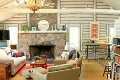 Light gray paint and lots of natural light take this cabin on a Michigan lake out of moody country