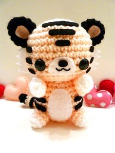 If anyone is having trouble deciding what to crochet…hows about a Valentine's Day tiger amigurumi? :] Good idea? Bad idea? Who doesn't like a tiger amigurumi? Tigers and Valentine's Day makes perfect sense, right? The truth is we just really wanted to make a pink tiger. <3 It doesn't look like much, but this tiger …