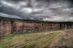 Ft. Morgan Exterior view of the interior wall at Ft. Morgan. The shot was taken standing on the exterior wall looking in towards the fort.