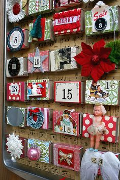 Advent calendar made from a cookie pan, match boxes decorated with scrapbook paper, and magnets :)