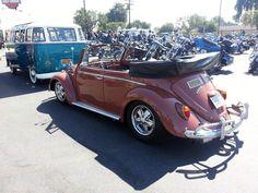 Joe Martinez, of Los Angeles, California, U.S.A. 1966 Coral Red VW Beetle Convertible. 3inch narrowed beam, reinforced gears trans 1835cc, 45 Dellortos, Porsche alloys 41/2 & early 6 real ones. Porsche H1 headlights. Disc brakes all around. Joe is member of Volksstyle Car Club.