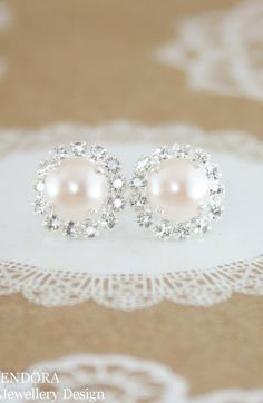 Creamrose pearl earrings,pearl earrings,pearl stud earrings,pearl halo earrings,swarovski pearl earrings,swarovski earrings,Swarovski pearl  Great size and sparkle for cream pearl bridal earrings, ivory pearl wedding jewelry, cream pearl earrings and rose gold wedding theme.  Shown in bright silver stud setting with creamrose pearl - other options available - please select your choice.  Creamrose is an ivory pearl with just the slightest tinge of pink to it. ♥ Swarovski crystal pearl - 8mm…