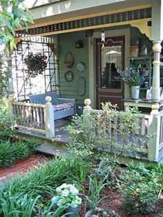 omg I LOVE cute, whimsical porches like this!!!