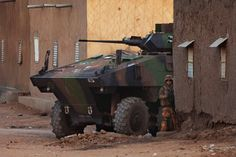 Mali Fighting  .  A French soldier stands next to an armoured vehicle during an operation to collect explosives found in a house in Gao, Feb. 27, 2013.    Read more: http://world.time.com/2013/01/24/war-in-mali-france-and-african-allies-take-on-islamist-militants/#ixzz2P4XsKmRb