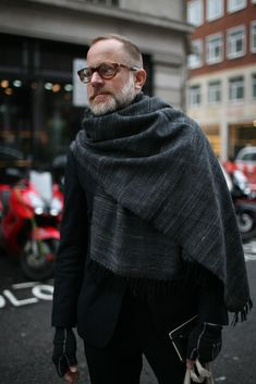 Bruce Pask. Grey woven scarf, black suit and bicycle gloves.