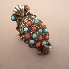 """Silver, turquoises, corals, Nepal     Description      This ring from Katmandu  is remarkable for the quality of its turquoises and corals as well as its design ...      Size:9 adaptable    Weight:16,5gr  www.halter-ethnic.com    see """"My Lucky Finds"""""""