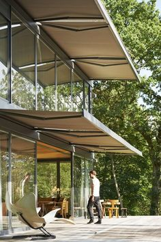Prefab house by Philippe Starck I like how it looks like the awnings might be integrated into the design instead of tacked on afterward