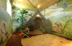 Jungle mural in boy's play house in Denver. This was just a run down storage shed that Dad decided to transform into a wonderland for his little boy. Paint Decor Studio painted the murals, built the tent, painted the floorcloth (map of Livingstone's Africa) and added 3D bits of fake foliage and netting to the ceiling. This is truly a Paint Decor room from floor to ceiling and I was grateful to have the opportunity to bring so many of my own ideas to a project. My inner set designer had a lot…