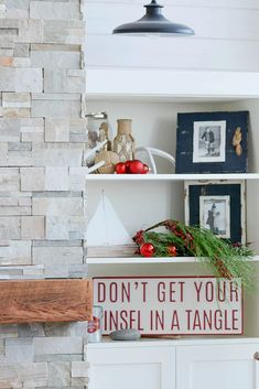 Decorate any shelf of built-in with cozy Christmas decor to create a holiday statement.  Plus, 5 tips for cozy cabin style during the holiday season. #shelfie #holidaydecor #Christmasdecor
