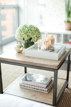 Farmhouse end tables beside the traditional sofa with matching farmhouse coffee table. Keep simple decor with flower arrangement and candles.