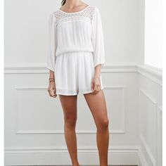 Ivory lace Romper Ivory laced top romper. Slit in upper back that has one delicate button at the top. Beautiful lace around neckline. Wide thigh area. Elastic a at waist and around forearms. 3/4 sleeve. Bought and needed something more fancy. Forever 21 Pants Jumpsuits & Rompers