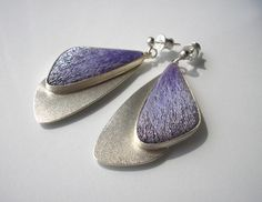 Jolanta Bromke, Earrings on a stick made from silver 930 Silver mold filled with hand made embroidery cotton and synthetic shiny stitch in gentle violet colors. Handmade Silver Jewellery, Enamel Jewelry, Earrings Handmade, Jewelry Art, Beaded Jewelry, Jewelry Design, Dragon Jewelry, Magical Jewelry, Textile Jewelry