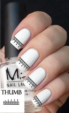 Lace decal on white nails.