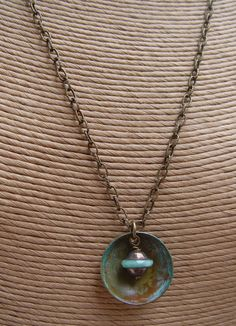 Handmade Turquoise Glass Beads, Brass Saucer and Fancy Brass Necklace. $29.50, via Etsy.