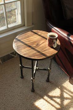 "21"" high and top 18"" in diameter Hand Scraped Industrial Iron Pipe Table by IronCrafts on Etsy, $99.00"