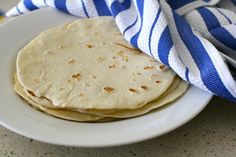 """DIY Flour Tortillas ~""""I made these from start to finish in just under an hour (and that was with taking pictures for you all!)  As far as shaping equipment goes, all you need is a work surface and a rolling pin.  And of course, as with so many other things that are homemade, they just taste so much better."""""""