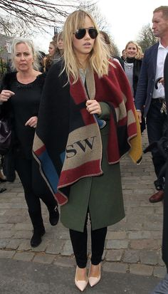 Suki Waterhouse in her monogrammed Burberry. While on the street in London.