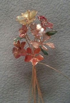 In progress, made with wire and nail polish. 20 Ways to Use IKEA's RIBBA Picture Ledges All Over the House How To Make Nail Polish Gems Nail Polish Flowers, Nail Polish Jewelry, Nail Polish Crafts, Nail Polish Art, Wire Flowers, Plastic Flowers, Fabric Flowers, Paper Flowers, Wire Crafts