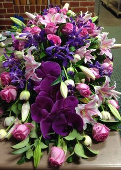 Purple and pink casket spray. Funeral Floral Arrangements, Rose Arrangements, Casket Flowers, Funeral Flowers, Funeral Caskets, Funeral Sprays, Casket Sprays, Funeral Planning, Memorial Flowers