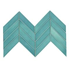 Kiln Chevron Teal Agate - Blue/Green Ceramic Tile - Our Signature Kiln Chevron Tile in the tropical blue Teal Agate has wonderful variation within each tile. It is normal to have dark and light tiles within each square foot. Sold loose by the square foot there are 9 tiles per square foot unit. This tile is well suited as kitchen backsplash tile, bathroom tile or as any indoor wall tile. All Kiln Ceramic Chevron tiles are handcrafted in the USA. Our artisans take care to ensure the highe...