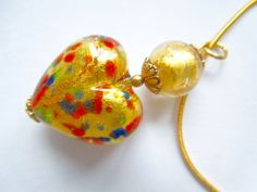 Gold Murano glass heart pendant with gold filled by artbypolli