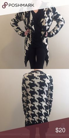 Houndstooth cardigan The coziest mid length cardigan you'll ever find! A large houndstooth print in cream and black. This sweater is in perfect condition and goes with anything. Great to throw on over a comfy top or dress up for a night out! The perfect length for jeans or leggings! Forever 21 Sweaters Cardigans