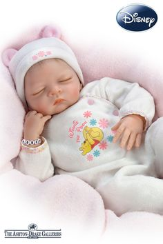 So Truly Real baby doll by Waltraud Hanl in a snuggly outfit featuring Winnie the Pooh artwork and she's weighted. Do-it-yourself personalization kit!
