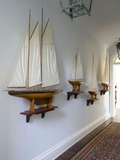 sailboats mounted on wall, lovely statement  art/sculpture, creates a mood