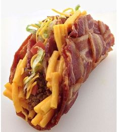 Is that macaroni and cheese inside a bacon shell?