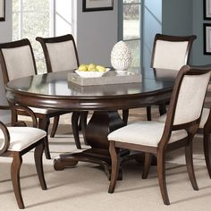 This beautiful pedestal dining table and chair set will be a lovely addition to your semi-formal dining room. The smooth table top features a convenient leaf so the length can be extended from 54 to 74 inches, allowing you to easily accommodate guests. The matching chairs have softly rolled backs and plush seats, covered in a beige fabric that will blend beautifully with your home decor. Special Price: $792.00